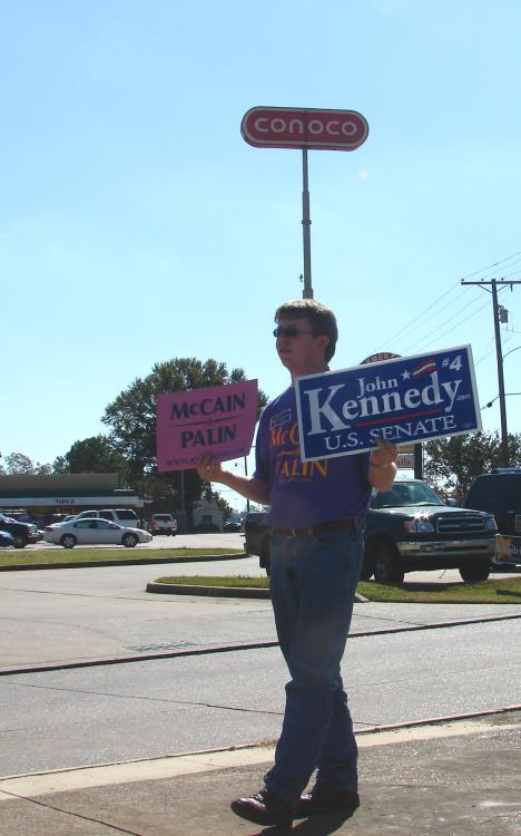 A supporter of Sen. John McCain holds a sign while standing at the intersection of Jackson Street and MacArthur Boulevard in Alexandria, Louisiana