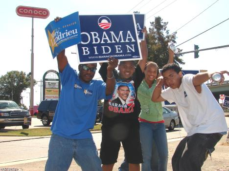 Supporters of Barack Obama hold signs near the intersection of Jackson Street and MacArthur Boulevard
