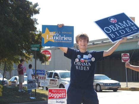 Christian Adams, the youngster who gained national attention for writing a letter to Sen. Barack Obama earlier this year, holds a sign for his candidate while standing at the intersection of Jackson Street and MacArthur Boulevard in Alexandria, Louisiana.