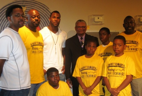 Nic Harris with the Young Intellectuals and Pastor Clarence Dupar Jr.